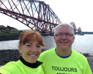 Selfie time for my dynamic crew at the base of the towering original Forth Bridge.